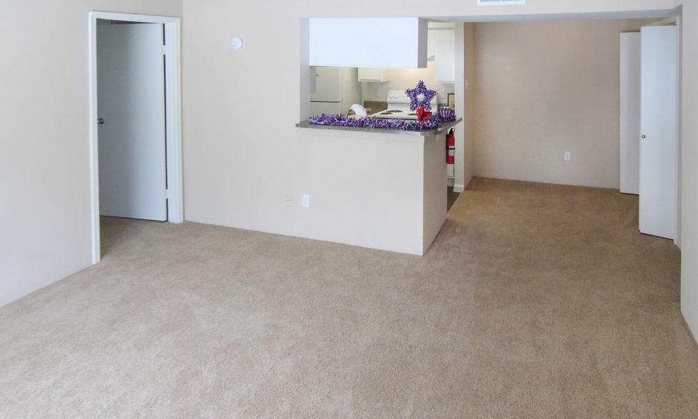 Living room at Newport Oaks Apartments in Alvin, TX