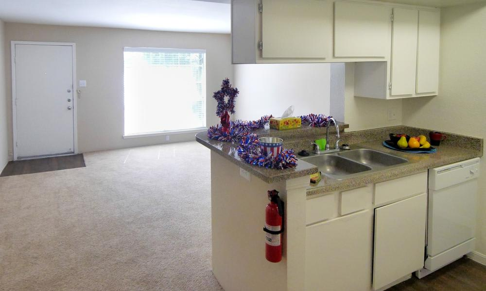 Stainless-steel appliances at apartments in Alvin, TX