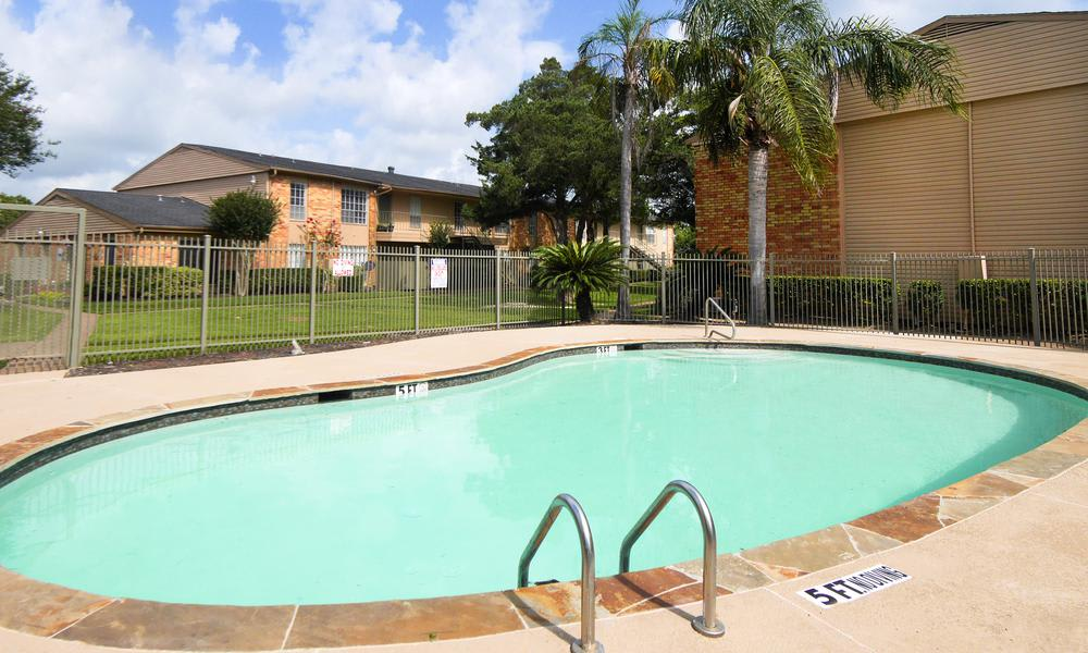 Swimming pool at Newport Oaks Apartments in Alvin, TX