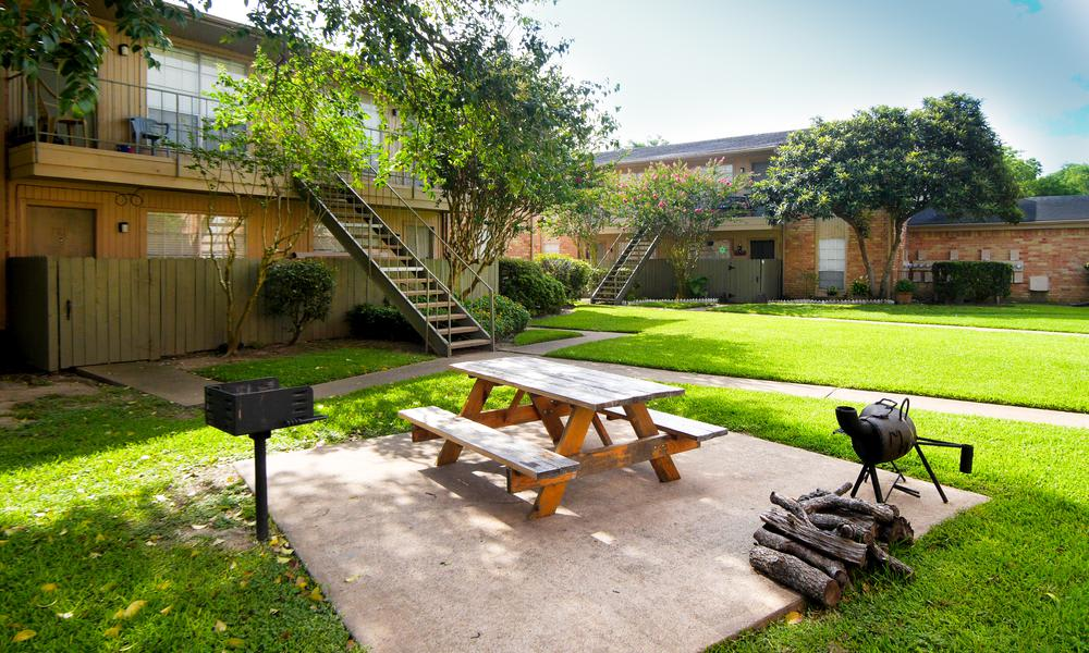 Outdoors Bench at Newport Oaks Apartments in Alvin, TX