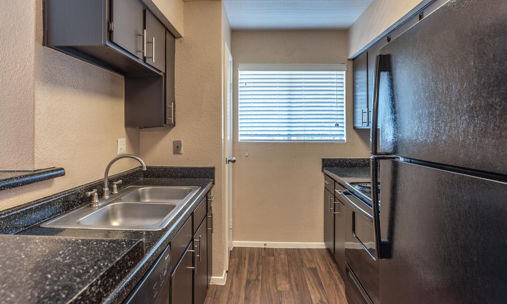 Narrow Design Kitchen Room at Verano Apartments in Houston, TX