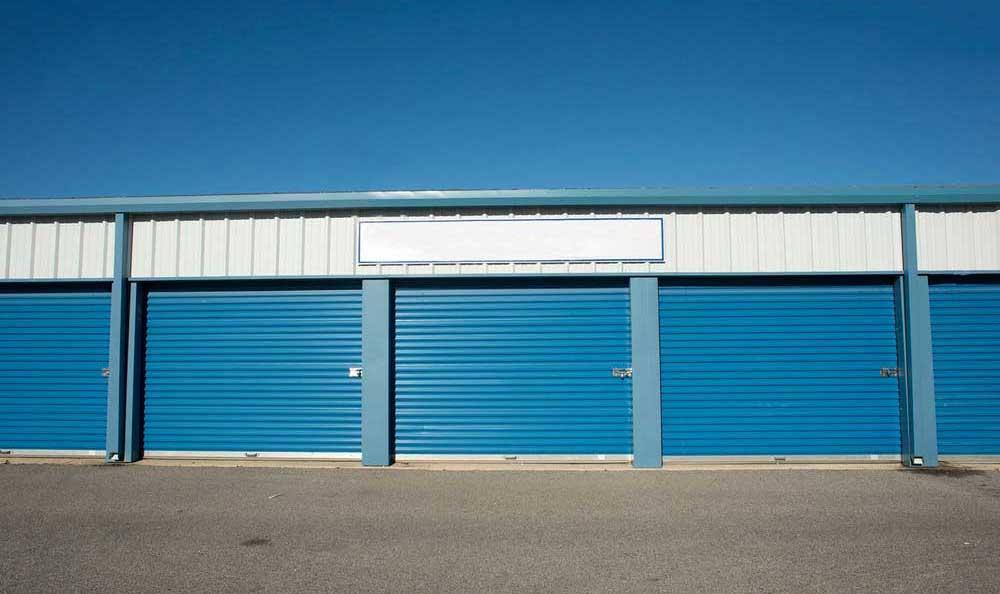 Wide roll up doors at Northwest Crossing Self Storage.