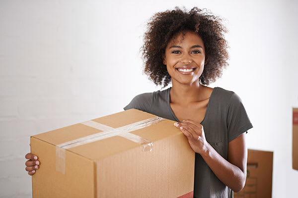Woman packs a box for storage at ClimaSafe Self Storage