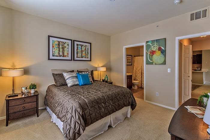 Masterbedroom at The Crossings at Bear Creek Apartments in Lakewood,