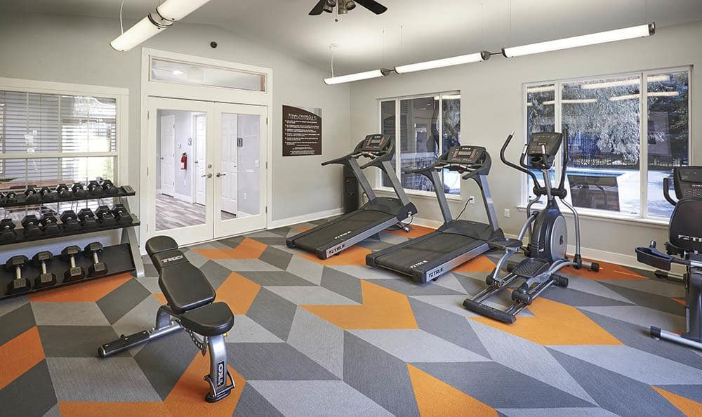 Fitness Center with free weights and cardio machines At Crossroads at City Center Apartments