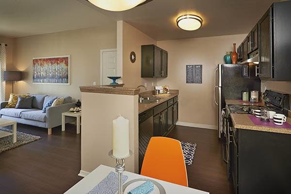 Kitchen and Living Room at Crossroads at City Center Apartments in Aurora