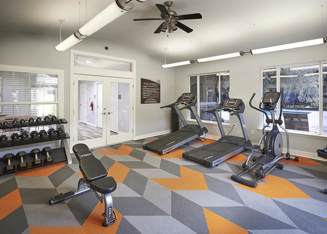 Fitness center at Crossroads at City Center Apartments