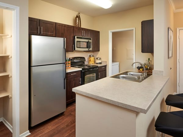 Kitchen at Legend Oaks Apartments in Denver