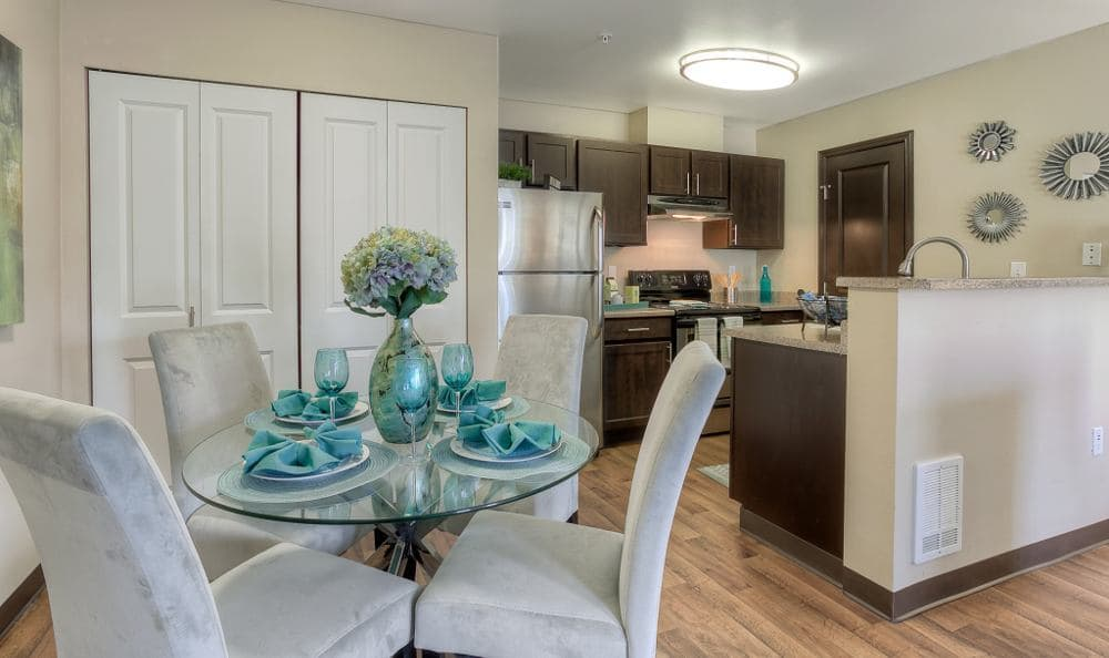 Dining area and kitchen at Pebble Cove Apartments in Renton