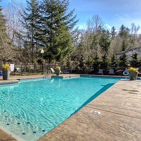 Refreshing swimming pool at Pebble Cove Apartments in Renton