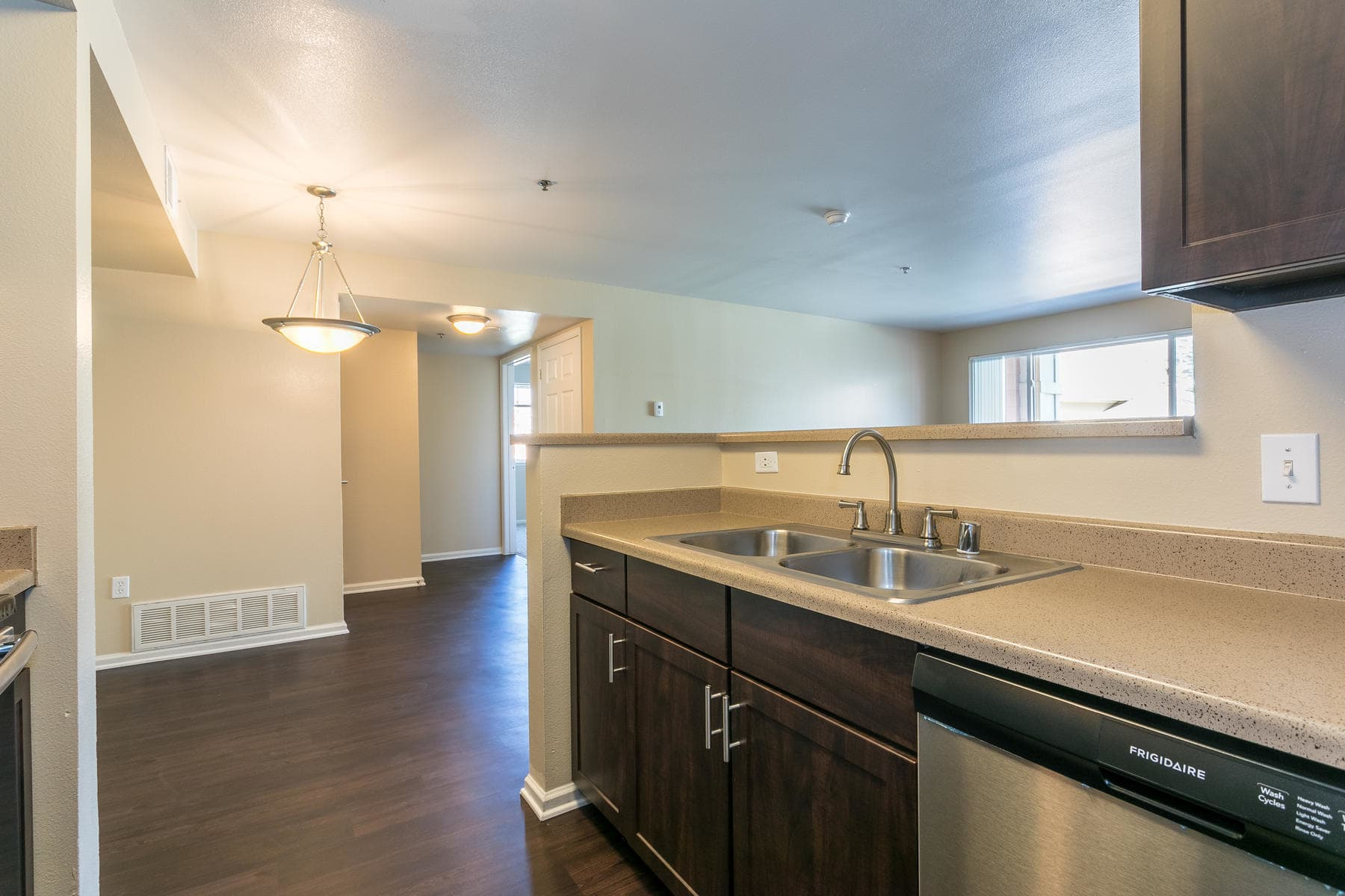 Kitchen/Living Room at The Bluffs at Castle Rock Apartments