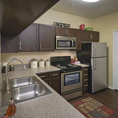 brown renovated kitchen  at Hawthorne Hill Apartments in Thornton