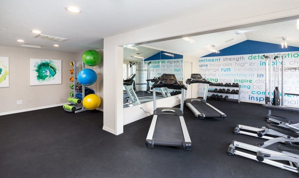 Living at Meadows at Cascade Park Apartments includes a gym