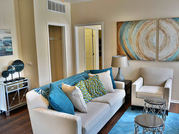 Furnished Model Living Room at Promenade at Hunter's Glen Apartments in Thornton