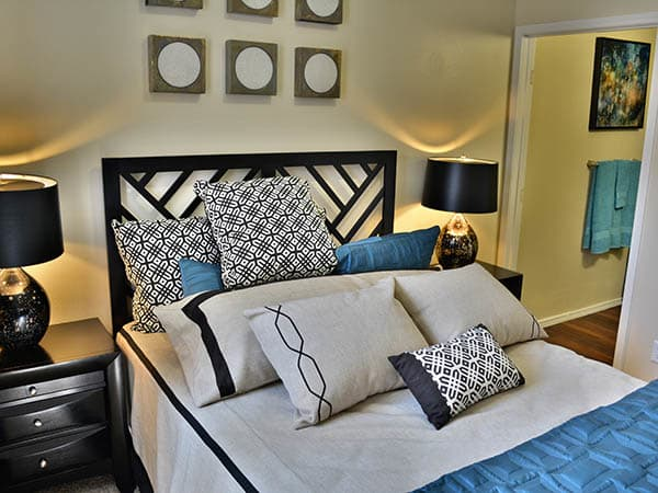 Furnished Master bedroom at Promenade at Hunter's Glen Apartments in Thornton,