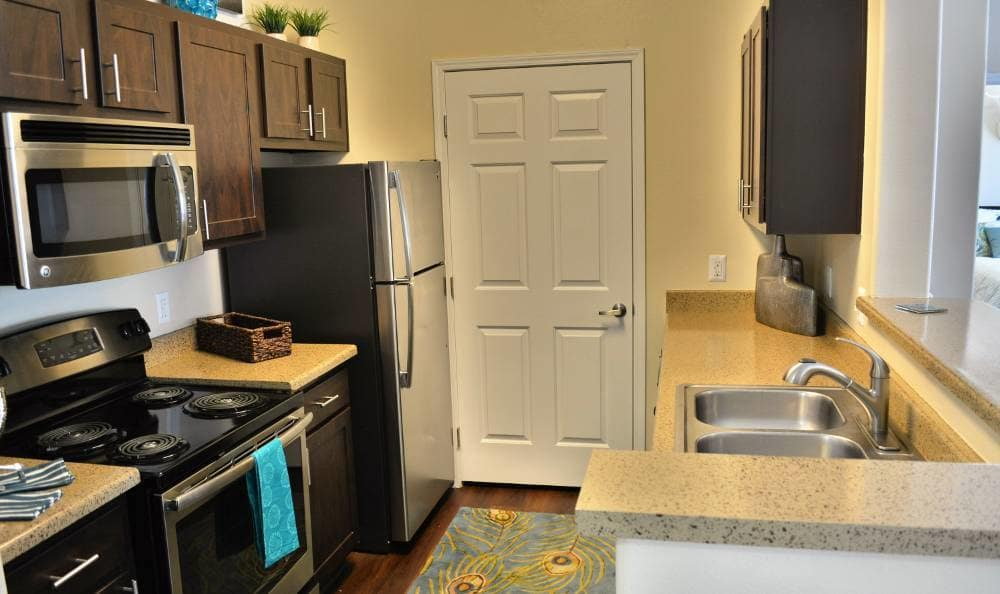 Well organized kitchen in our floor plans at Promenade at Hunter's Glen Apartments in Thornton