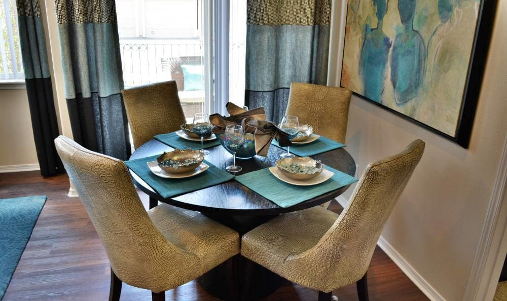 Dinning table in Promenade at Hunter's Glen Apartments