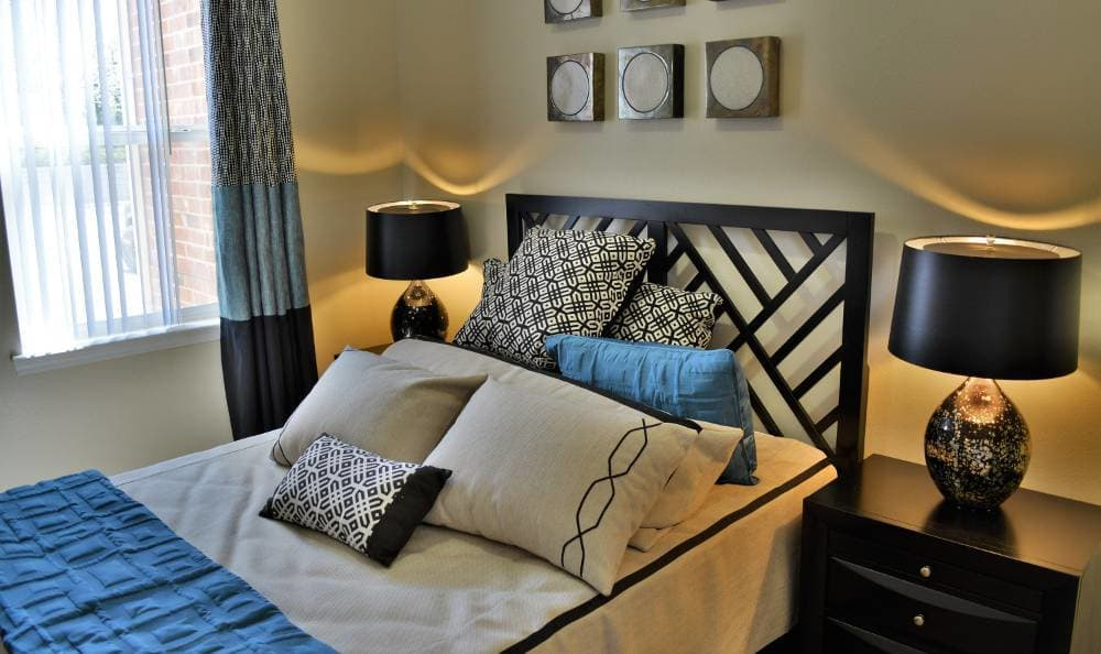 Comfortable bedroom at Promenade at Hunter's Glen Apartments