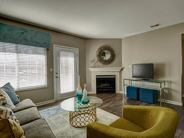 Modern Living Room with Fireplace at Villas at Homestead Apartments in Englewood,