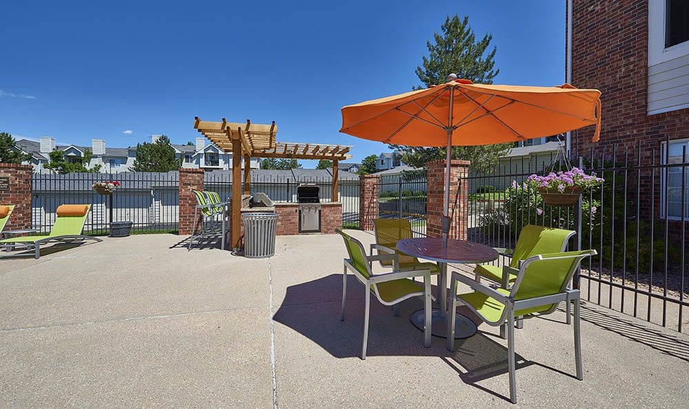 BBQ area by Villas at Homestead Apartments's pool