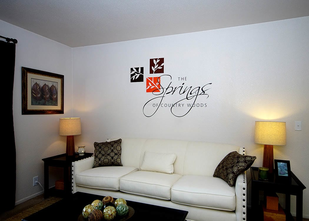 living room at Springs of Country Woods Apartments in Midvale