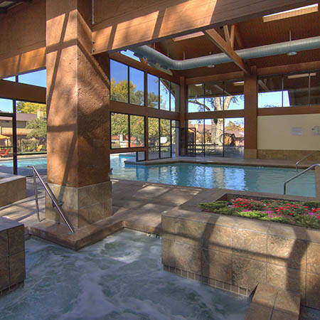 Refreshing swimming pool at Springs of Country Woods Apartments in Midvale