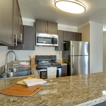 brown renovated kitchen model at Carriage House Apartments in Vancouver