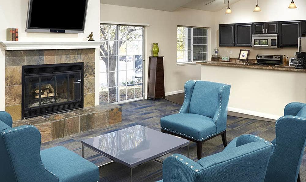 community clubhouse with fireplace at Bluesky Landing Apartments