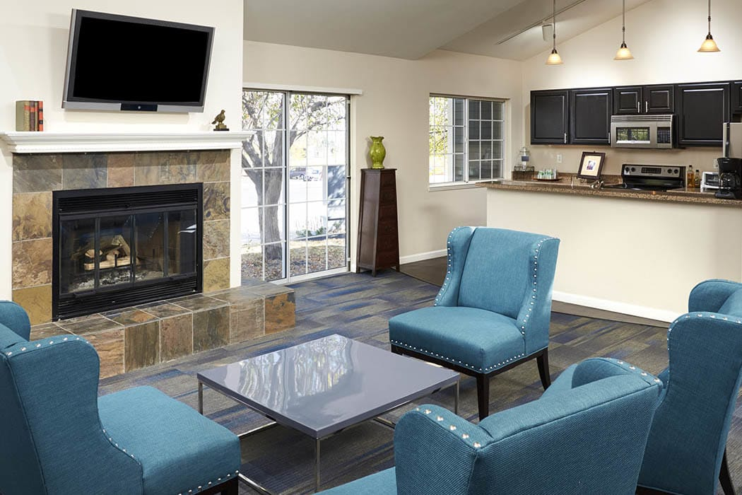 Community clubhouse and lounge area at Bluesky Landing Apartments in Lakewood