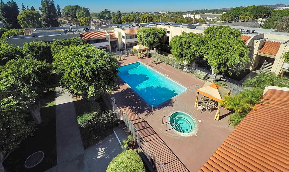 Aerial View Of A Pool At Kendallwood Apartments