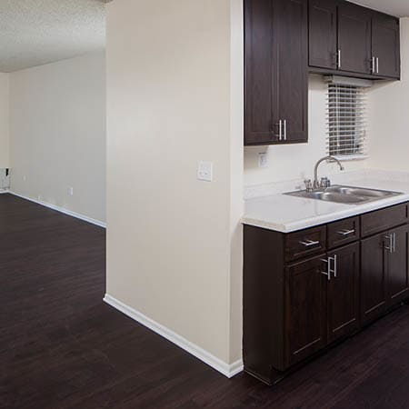 Kitchen and Living Room at Kendallwood Apartments in Whittier,CA