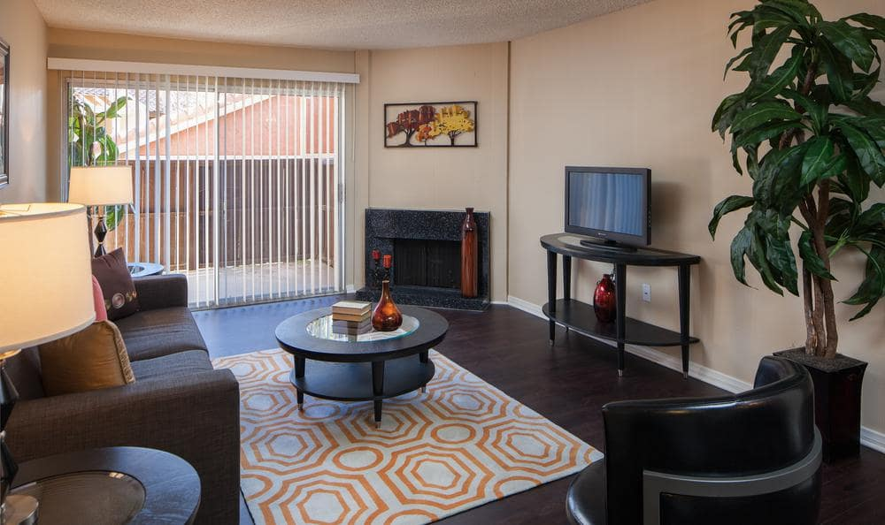 Well Decorated Living Room With Large Window at Shadow Ridge Apartments in Oceanside, CA