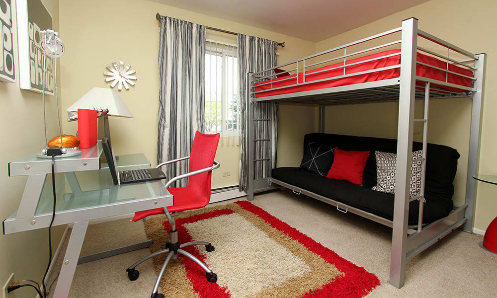 Apartment bedroom, furnished at Riverstone Apartments in Bolingbrook, Illinois