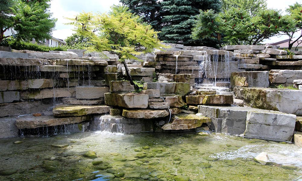 On-site flowing Creek At Riverstone Apartments in Bolingbrook, Illinois