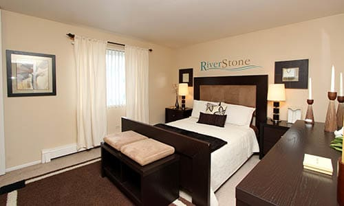 Furnished Master Bedroom at Riverstone Apartments in Bolingbrook, Illinois