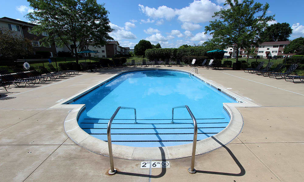 Pool With Chairs At Riverstone Apartments In Bolingbrook IL