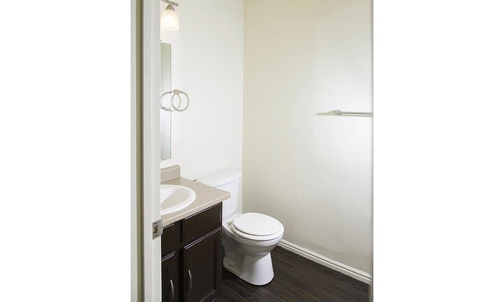 Hardwood floored restroom at Shadowbrook Apartments