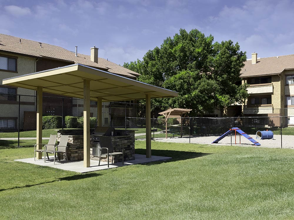 Bbq area and park at Shadowbrook Apartments