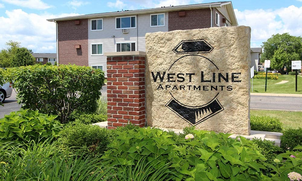 Signage in front of West Line Apartments in Hanover Park, Illinois