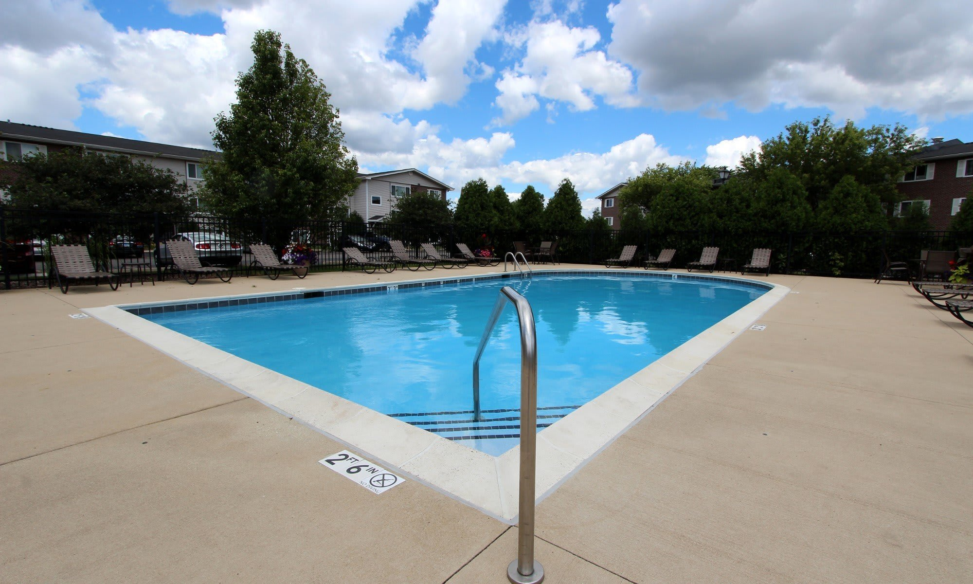 The pool area with lounge chairs at West Line Apartments in Hanover Park, Illinois