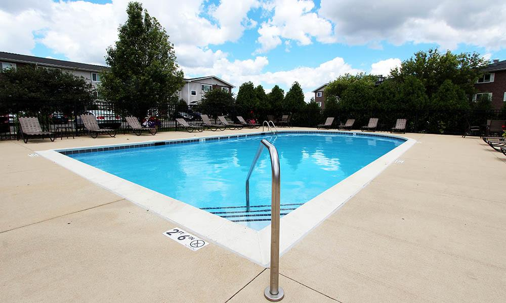 Sparkling Pool Area with lounge Chairs At West Line Apartments in Hanover Park, Illinois