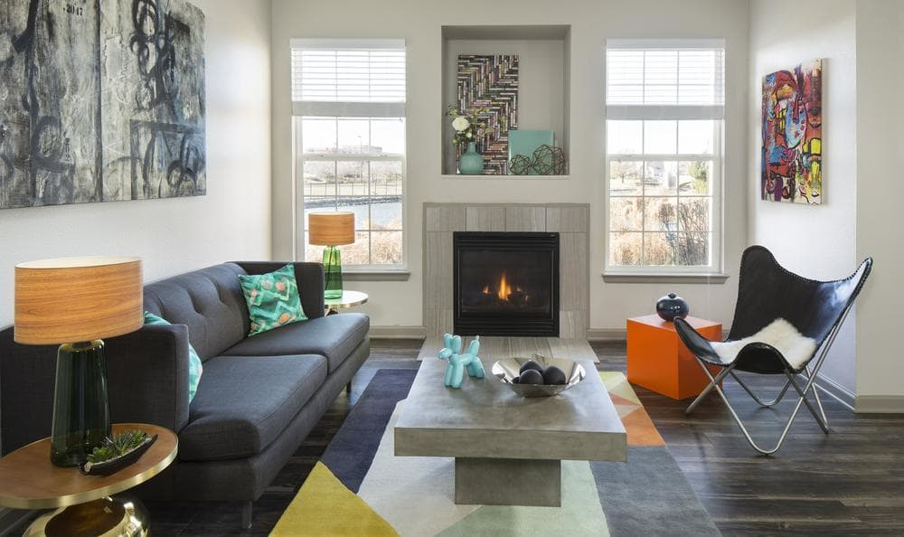 Living Room With Chimney at Gateway Park Apartments in Denver, CO