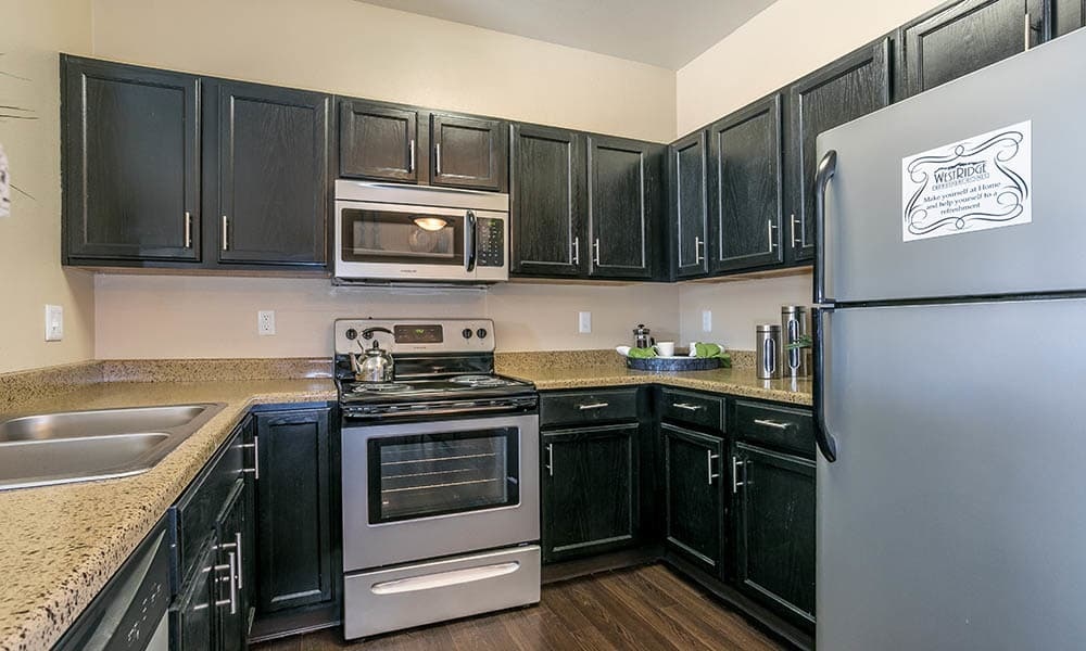 Fully Equipped Kitchen at Westridge Apartments in Aurora, CO
