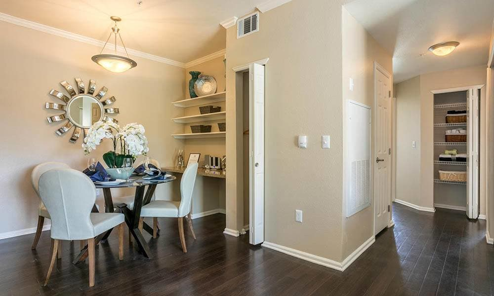 Dining room with hard wood flooring at Westridge Apartments in Aurora, CO