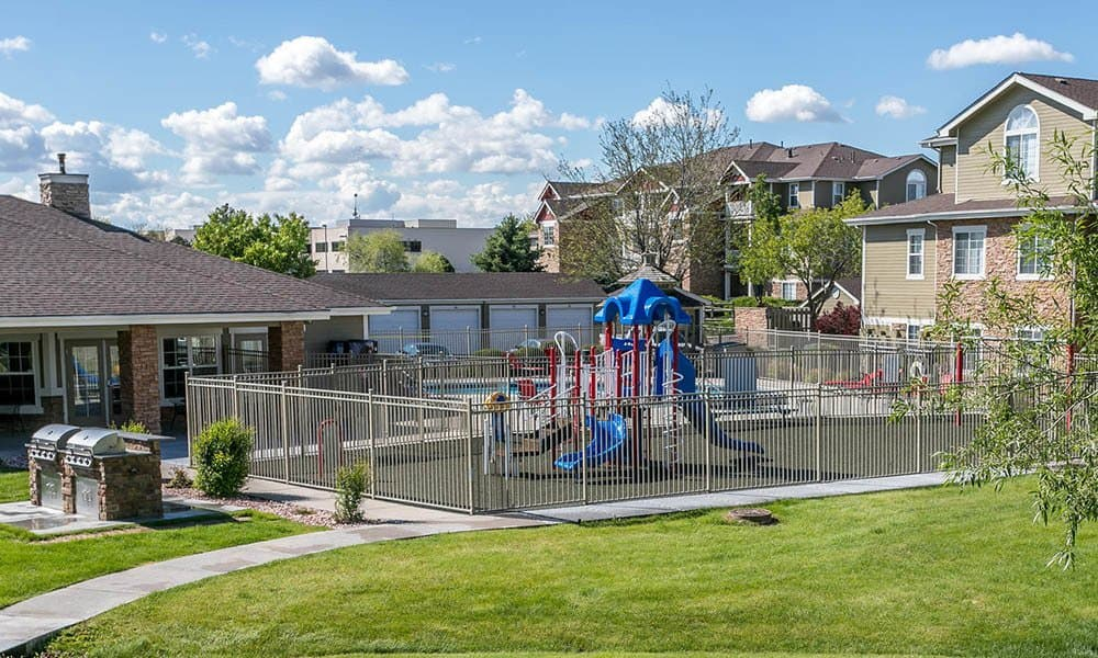 Playground with party area at Westridge Apartments in Aurora, CO