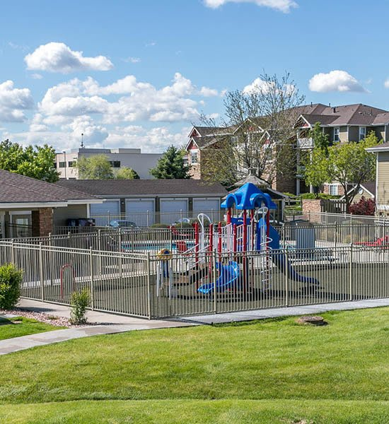 Exterior amenity view of playground area at Westridge Apartments in Aurora