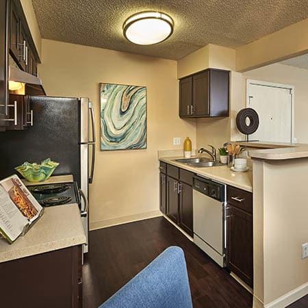 brown renovation kitchen at Alton Green Apartments in Denver