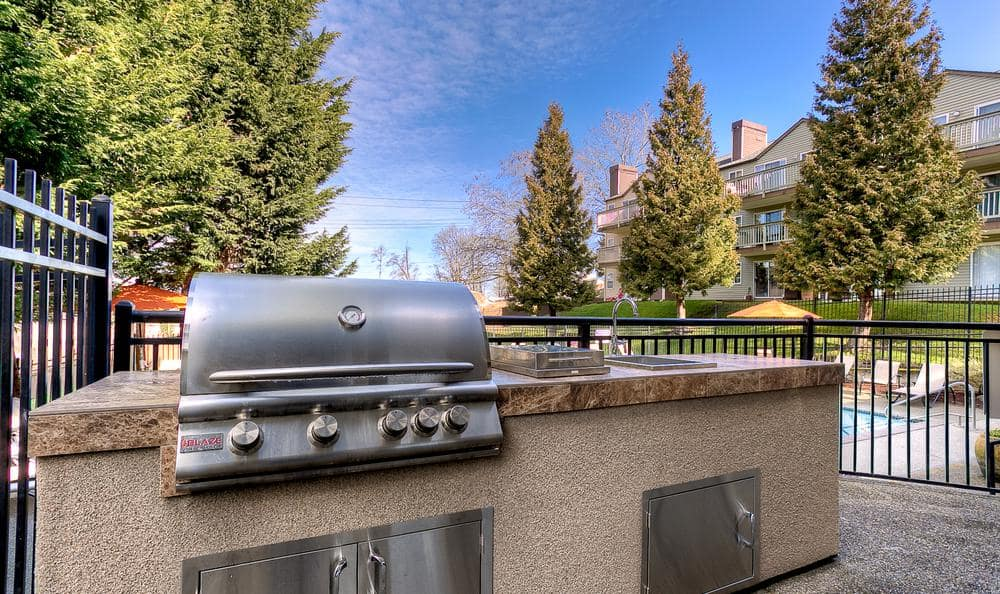Grill near pool at Park South Apartments in Seattle, WA
