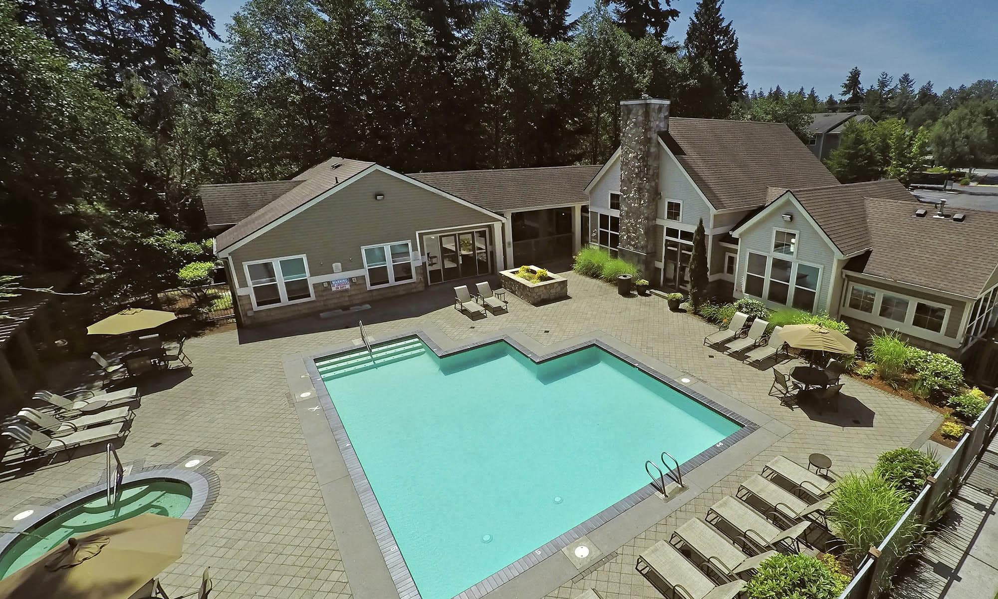 Aerial view of the pool and clubhouse at Wildreed Apartments in Everett, WA