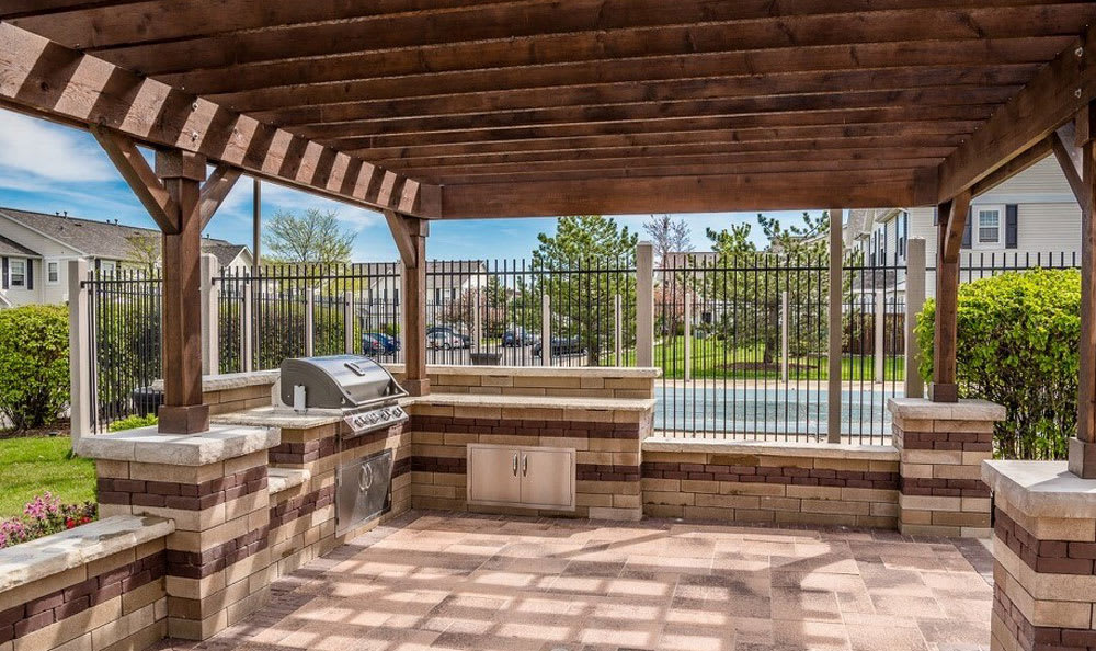 Apartments in Aurora feature a patio and grill space